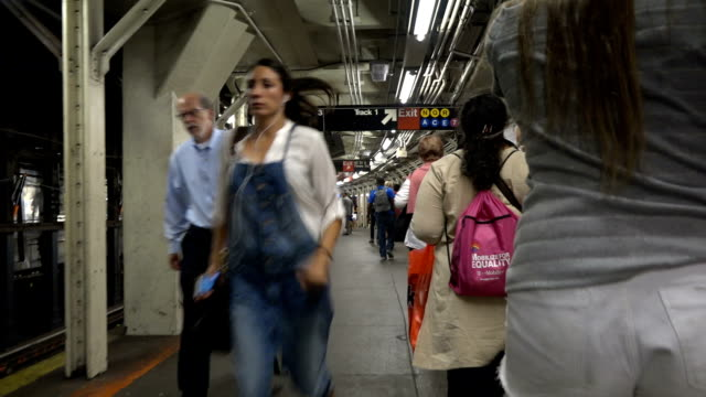 """summer evening rush hour commuters at the exiting the grand central station - times square shuttle """"s"""" subway train platform / footage taken of... - 42nd street stock videos & royalty-free footage"""