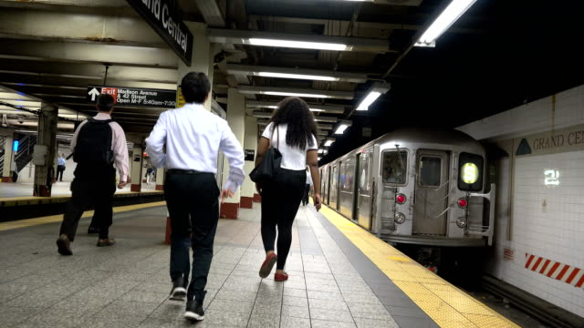 """Summer evening rush hour commuters at the Grand Central Station shuttle """"S"""" subway train platform / Grand Central Station Subway lines here include..."""