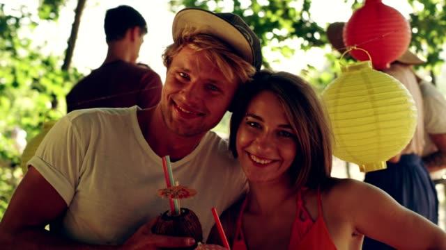 Summer garden party. Attractive couple looking at camera