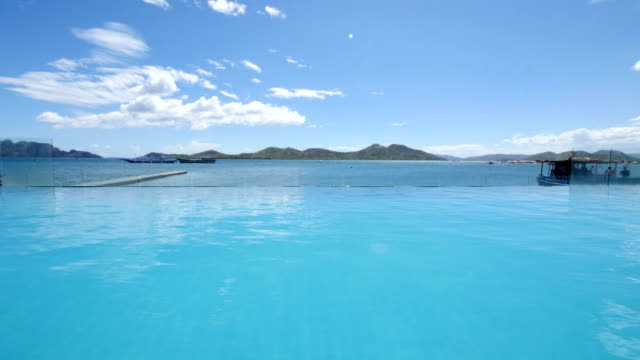 summer holidays at an infinity pool - infinity pool stock videos & royalty-free footage