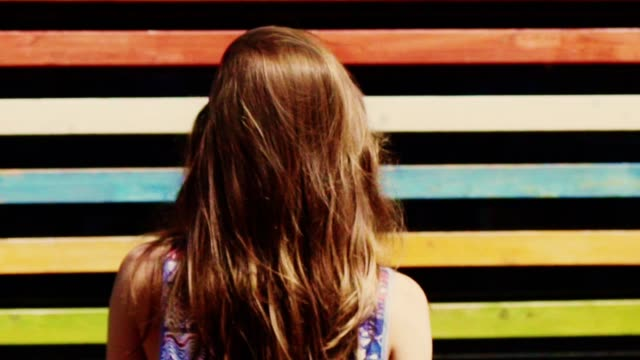 summer in the city. colorful stripy background and woman - brown hair stock videos & royalty-free footage