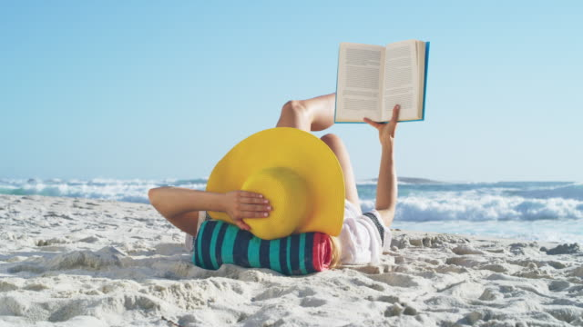 summer is for long lazy days at the beach - reading stock videos & royalty-free footage