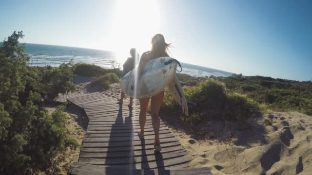 summer is here: pov surfer girl in action - surfboard stock videos & royalty-free footage