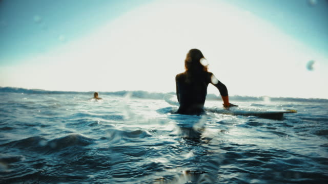 summer is here: surfer girls in action - surfboard stock videos & royalty-free footage