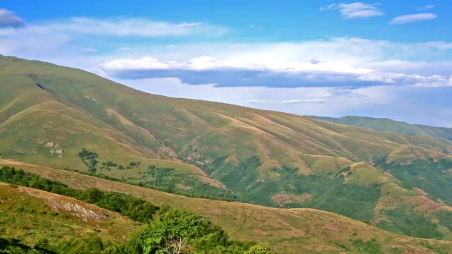 Summer landscape in mountains and light blue sky