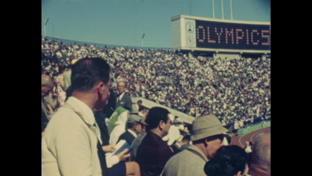 summer olympic games tokio 1964 national stadium day of the opening ceremony sign shows way to the national stadium people arriving audience entering... - 開会式点の映像素材/bロール