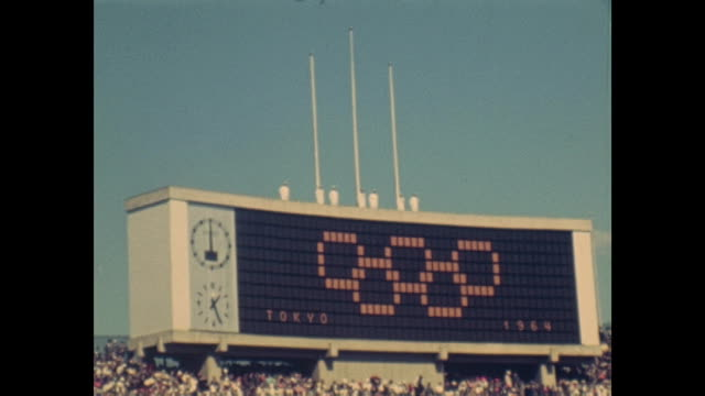 vídeos de stock e filmes b-roll de summer olympic games tokio 1964 national stadium day of the opening ceremony japanese music band marching in band of the fire defence board walking... - 1964