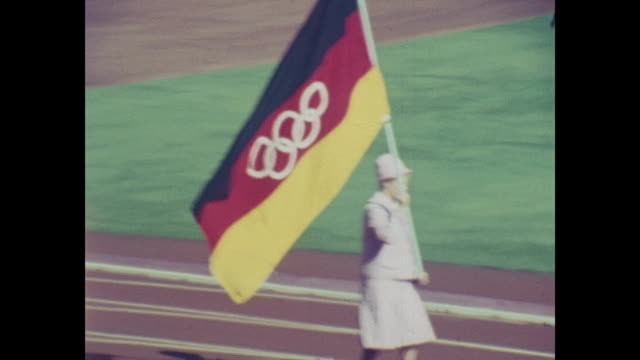 summer olympic games tokio 1964 national stadium day of the opening ceremony filmed out of the audience athletes of all nations are marching in... - 1964 bildbanksvideor och videomaterial från bakom kulisserna