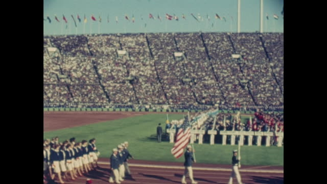 summer olympic games tokio 1964 national stadium day of the opening ceremony filmed out of the audience athletes of all nations are marching in... - opening ceremony stock videos & royalty-free footage