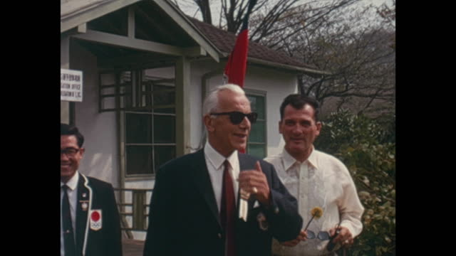 summer olympic games tokio 1964 officials in front of the house of the liechtenstein delegation office - summer olympic games stock videos and b-roll footage