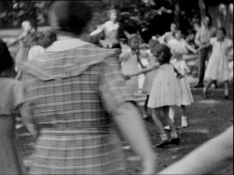 1938 b/w ms summer play and dance called ringelrei, kids playing and dance in circles / thuringia, germany - 1938 stock videos & royalty-free footage