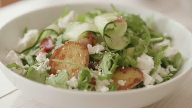 summer potato salad with feta flakes - feta stock videos & royalty-free footage