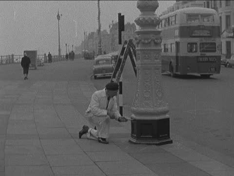 summer preparations at brighton; england: sussex: brighton: ext gv brighton pier captain knight interview sof various of workmen painting and... - swimwear stock videos & royalty-free footage