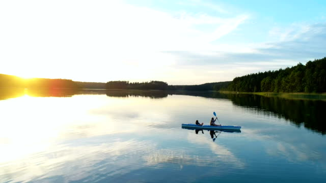 summer relaxing activity. kayaking during sunset - using a paddle stock videos & royalty-free footage