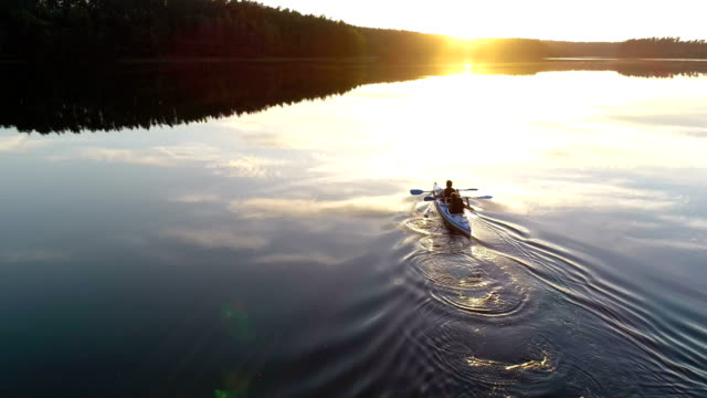 summer relaxing activity. kayaking during sunset - kayaking stock videos & royalty-free footage