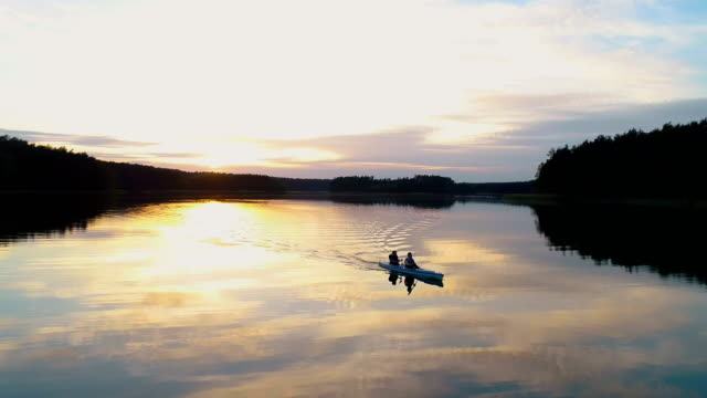 Summer relaxing activity. Kayaking during sunset