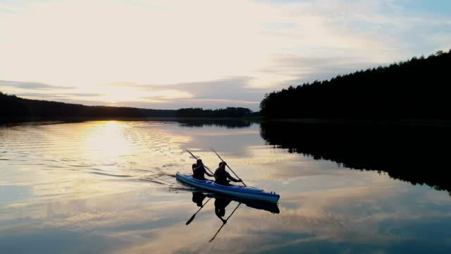 Summer relaxing activity. Kayaking during sunset