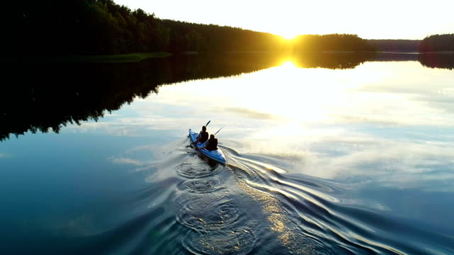summer relaxing activity. kayaking during sunset - lake stock videos & royalty-free footage