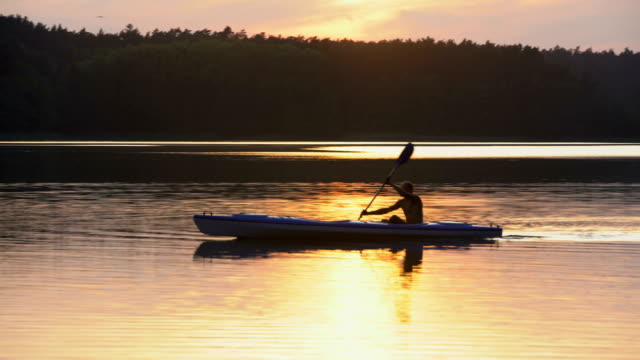 summer relaxing activity. kayaking during sunset - kayaking stock videos & royalty-free footage