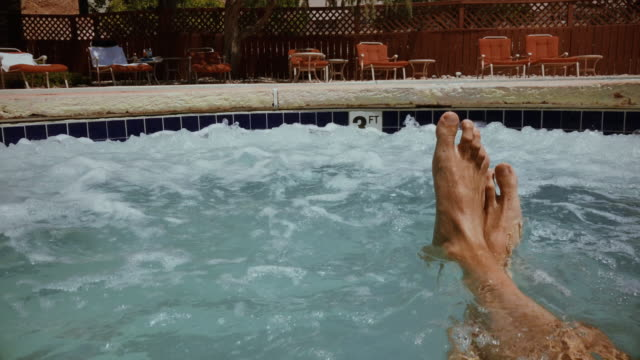 vídeos de stock e filmes b-roll de summer relaxing point of view: in a hot tube pool - sitting