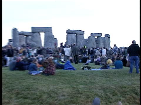 U'LAY ENGLAND Wiltshire Stonehenge EXT Crowds gathered round Stonehenge at day break