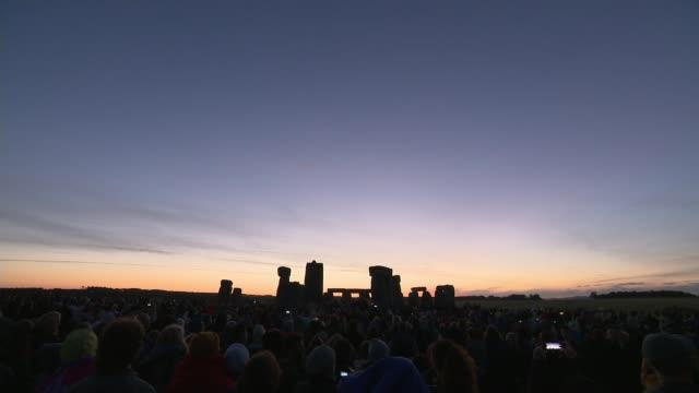 Summer Solstice celebrated at Stonehenge ENGLAND Wiltshire People gathered at Stonehenge as the sun rises on the Summer Solstice the longest day of...