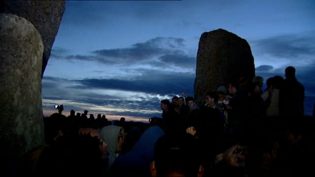 summer solstice celebrations at stonehenge more shots people gathered around stone circle for summer solstice / people wearing hats and drinking /... - summer solstice stock videos and b-roll footage