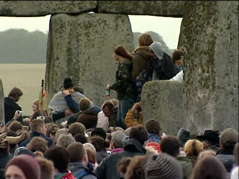 People gather at Stonehenge Scenes People gathered at Stonehenge / people around Stonehenge / people cheering /