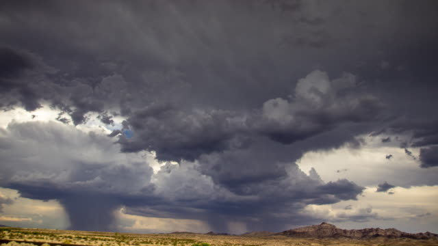 summer storm in the desert - time lapse - storm cloud stock videos & royalty-free footage