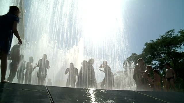 london southbank latitude festival anonymous shot of children playing in water fountain suffolk southwold crowds sitting in sunny field at latitude... - latitude stock videos & royalty-free footage