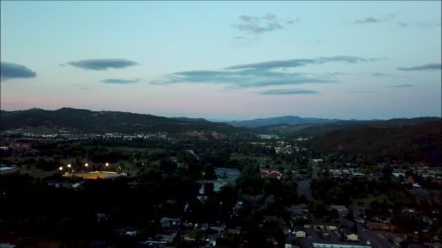 summer sunset drone flight over small town of roseburg, oregon - baseball sport stock videos & royalty-free footage
