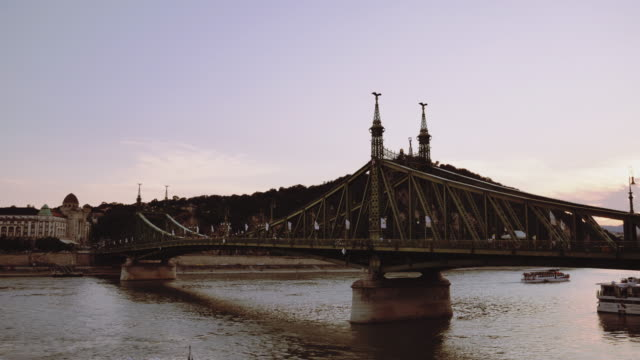 summer sunset in budapest, near liberty bridge and citadella - liberty bridge budapest stock videos & royalty-free footage
