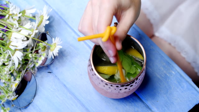 summer table with refreshing drink - mug stock videos & royalty-free footage