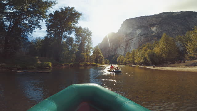 summer travel in the southwest usa: pov of a man rafting in merced river of yosemite - river merced stock videos & royalty-free footage