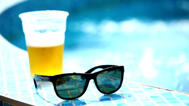 summer vacation calling. - empty beer glass stock videos and b-roll footage