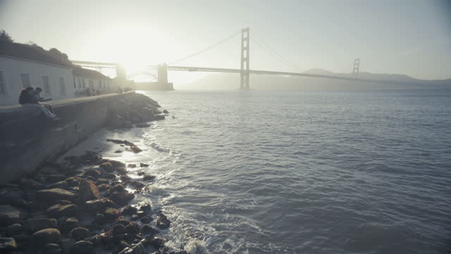 summer vacations in california: golden gate bridge of san francisco at sunset - san francisco bay stock videos & royalty-free footage