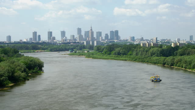 summer view of vistula riverside. warsaw skyline in background. drone point of view - warsaw stock videos & royalty-free footage