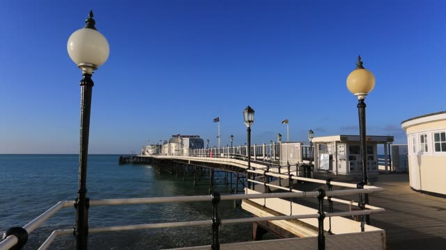Summer view over the Victorian pier at Worthing town, West Sussex, England, UK