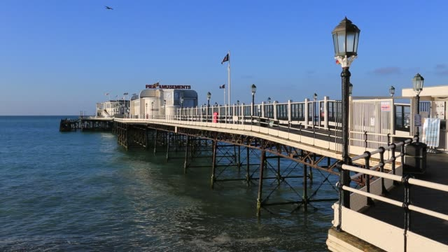 summer view over the victorian pier at worthing town, west sussex, england, uk - west sussex stock videos & royalty-free footage