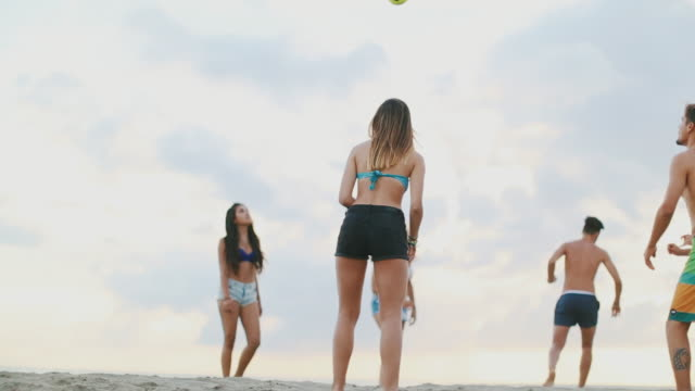 Summer with friends: play volleyball by the sea