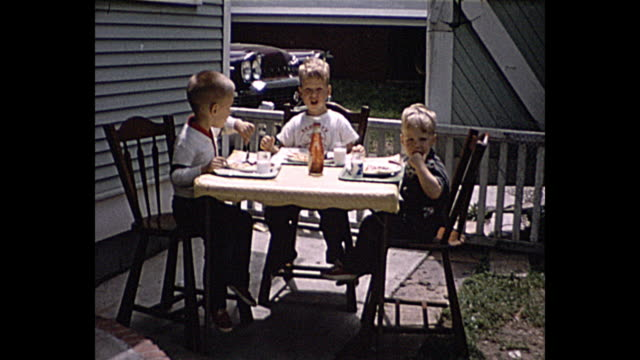1957 summer - young boys having a picnic in their front yard - neighbour stock videos and b-roll footage