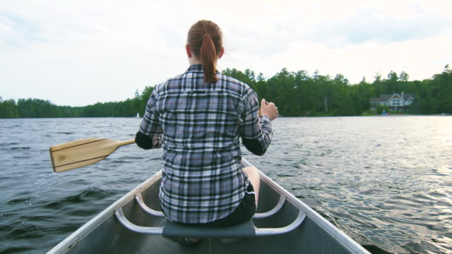 summertime at the lake - canoeing stock videos and b-roll footage
