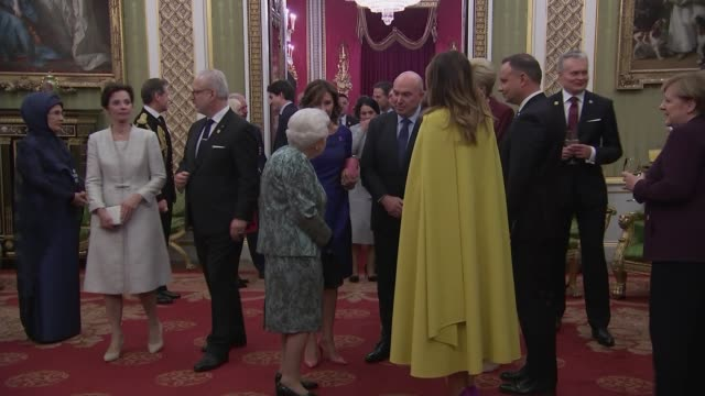 buckingham palace nato reception england london buckingham palace int boris johnson along and taking drink / queen elizabeth ii chatting as along... - chancellor of germany stock videos & royalty-free footage