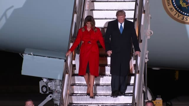 donald trump arrives in london england london stansted airport ext / night donald trump and melania trump towards from air force one and down steps... - melania trump stock videos & royalty-free footage