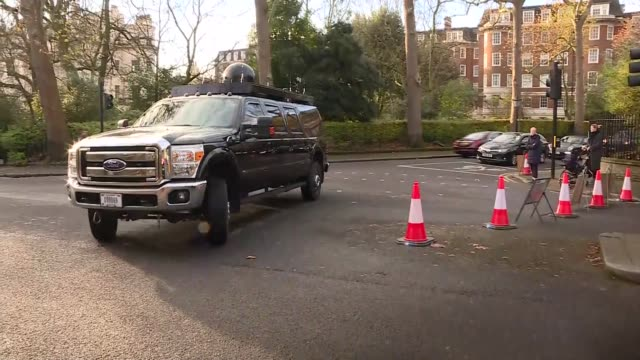 motorcades leaving the us embassy england london regent's park winfield house ext man attempting to sell donald trump memorabilia talking to police... - crime stock videos & royalty-free footage