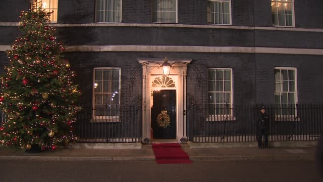 nato leaders depart from number 10 england london downing street ext / night **beware number 10 downing street with door decorated with christmas... - chancellor of germany stock videos & royalty-free footage