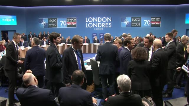 nato photocall and roundtable england hertfordshire the grove int nato members/delegates/attendees chatting in groups and taking seats for round... - chancellor of germany stock videos & royalty-free footage