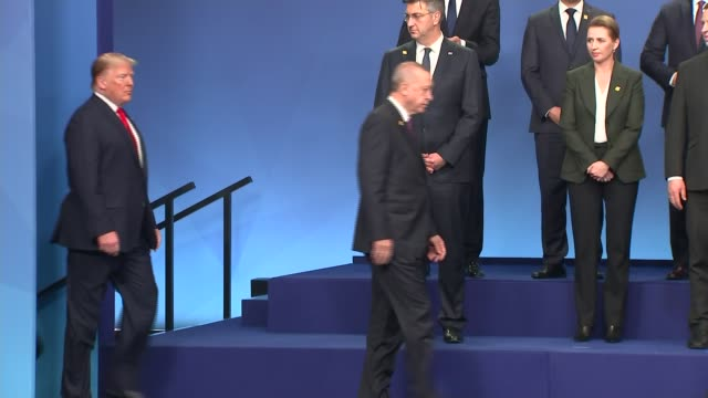 nato photocall and roundtable england hertfordshire the grove int bagpipe music playing sot / nato leaders along onto stage and posing for photocall... - chancellor of germany stock videos & royalty-free footage
