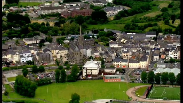 aerials of enniskillen air views enniskillen town including churches and other buildings / traffic along roads and bridges / lakes and surrounding... - g8 summit stock videos & royalty-free footage