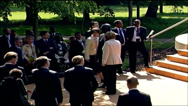 Africa aid pledge criticised EXT Angela Merkel organising delegates for announcement Delegates standing